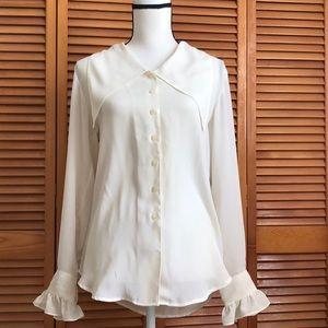 Delicate, cream blouse